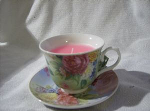 Decorative tea cup and saucer with candle green with roses *